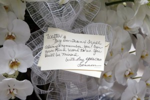 A card signed by Yoko Ono is attached to flowers sent to St. Bartholomew's Church on Park Ave. in Manhattan, the site of Walter Cronkite's funeral, Thursday, July 23, 2009 in New York. Cronkite died last Friday at his Manhattan home at age 92. (AP Photo/Kathy Willens)
